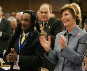 Laura Bush and Louie Culver give Culver's daughter, Sara Tucker, a standing ovation at the completion of her essay, Thursday, Oct. 27, 2005 at Howard University in Washington, at the White House Conference on Helping America's Youth.
