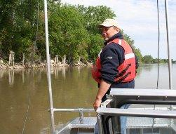 Aaron Deloney uses telemetry equipment to close in on a sturgeon in the Missouri River.