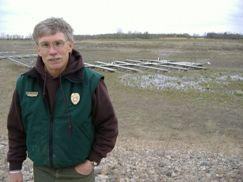 Ft. Stevenson State Park Manager Dick Messerly stands near a wooden boat dock now left high and dry.  This part of Lake Sakakawea has been dry since 2003.