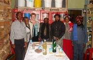 Kathy Goggin, third from left, of UMKC's psychology department, visiting with traditional healers at a South African Makhosi practice.