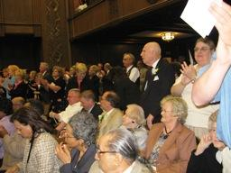 A full house at the city council chamber gives Mayor Mark Funkhouser and the new city council a standing ovation.