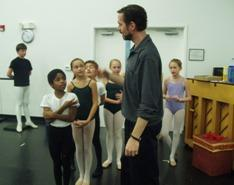 Ballet Master James Jordan conducts a rehearsal with dancer Tyler Palmer and other young Kansas City Ballet students.