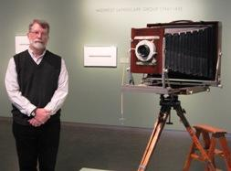 Keith Davis, Curator of Photography at the Nelson-Atkins, stands next to Sinsabaugh's banquet camera.