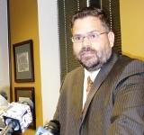 Phill Kline?s attorney Caleb Stegall at a press conference in Kline?s office