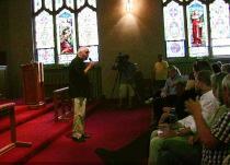 Dog Park Task Force member Tom Wyrsch hears comments on the Sunnyside plan at Broadway Methodist.