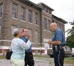 Margaret May (L) confers with  Captain Mark Terman (R) in front of Horace Mann School.