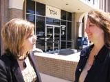 Cindy Circo (L), KC Councilmember and aide  Gina Boucher after foreclosure remedy  sessions are announced.
