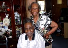 Housing repair recipient George A. Washington with Senior Companion Ruby Adams.