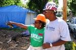 Shelly Allen (L) will own one of eleven Habitat for Humanity  homes. Job site supervisor Duane Tyson is at right.