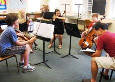 Students listen to feedback from Kansas City String Quartet Program faculty member Chung-Hoon Peter Chun