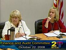 Finance and Audit committee members Deb Herman and Jan Marcason hear worrisome budget news.
