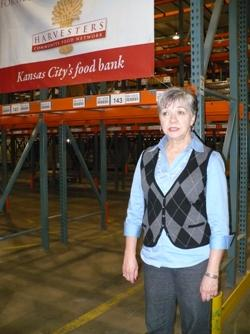 Karen Haren is standing in the Harvesters warehouse in Kansas City.