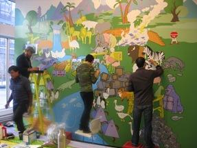 Members of the Okay Mountain collective work collaboratively on a mural at the Project Space.