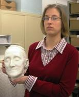 Holly Wright, Nelson-Atkins archivist, holds the death mask of Mary Atkins.