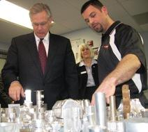 Governor Jay Nixon( D, Mo.) views student work at MCC Tech Center. Staff observe.