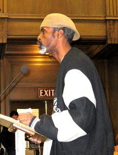 Kevin Hannibal  speaks   in  city council chambers.