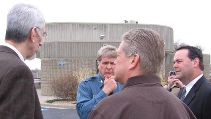 KC, Jackson County leaders: L to R. Mark Funkhouser, Jim Corwin(in uniform), Mike Smith(back to camera), Dan Tarwater dispute  tax use.