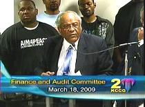 The Rev. Wallace Hartsfield and supporters of Aim4Peace urge a council committee not to eliminate funding for anti-violence and youth employment programs.