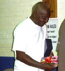 Alferd Williams, 71, clutches one more gift  book at school where he is a third grade student.