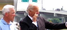 Contractor Bill Clarkson(l) views job site with V.P. Joseph Biden.