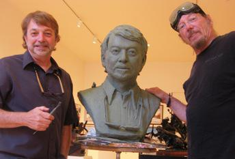 Louis Copt (left) and Jim Brothers (right) stand next to a bust-in-progress of Louis.