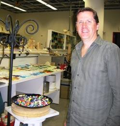 Mark Spencer, AKA Johnny Naugahyde, in the creative workshops area at Hallmark where he's learned to make glass beads.