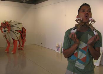 "Artist Juniper Tangpuz demonstrating one of his musical instruments called ""Piano Face."""
