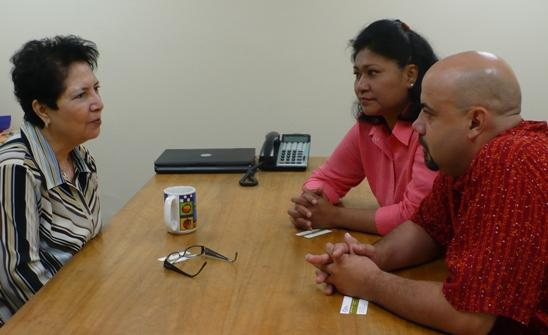 Harvest America's Licha Ybarra discusses mortgage options with Carmen and Luis Amiel.