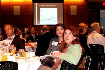 Intent on absorbing numbers at C of C economic forecast gathering at Johnson County Community College.(click to enlarge)