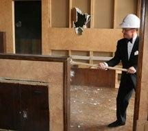 J. Kent Barnhart, Executive Director, helps out during the demolition.