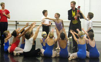Matthew Donnell, as Drosselmeyer, holding the Nutcracker at a Kansas City Ballet rehearsal.