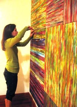 "Artist Holly Swangstu makes some last minute adjustments to her installation, ""Springtime in Winter."""
