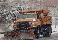 Orange snow plows contrasted with gray skies and white snowbanks as 2010 began.