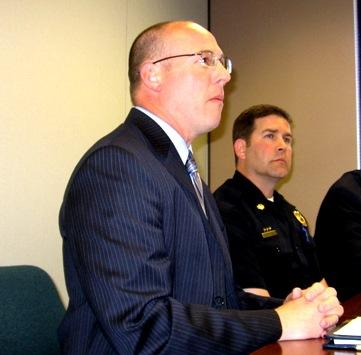 DA  Steve  Howe(L), Maj Simon Haffer, Overland Park P.D.  explain  shooting  by Prairie Village  officer.