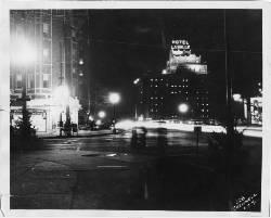 Looking west from the southwest corner of Linwood and Troost, at night. Shows the LaSalle Hotel and the Bodine Drugs.