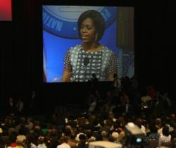 Michelle Obama speaks to NAACP convention in Kansas City.