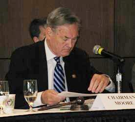 "Congressman Dennis Moore studying during his hearing ""Too Big Has Failed: Learning from Midwest Banks and Credit Unions.\"""