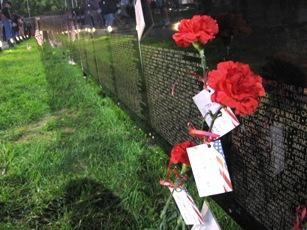 Vietnam Veterans Memorial  mobile  wall in Blue Springs, Mo.  touches relatives of the  dead.