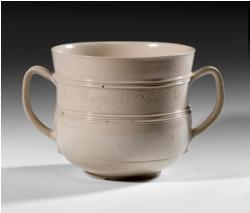 An important cup in the Burnap Collection: a salt-glazed stoneware vessel for caudle, a wine, milks, and spice drink. It's the earliest-known dated piece of English salt-glazed stoneware.