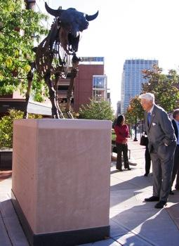 "Kemper Museum founder, Crosby Kemper, leans in for a closer look at Marc Swanson's ""Descent of Civilization (Bison Memorial)"" 2010, 9th and Broadway, KCMO"