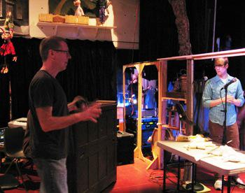 "Paul Mesner talks to puppeteer Spencer Lott before a ""Frankenstein"" rehearsal."