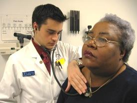 Simon Khagi, a fourth year medical student at UMKC, does a physical examination on Carolyn Gordon during clinic at Truman Medical Centers.