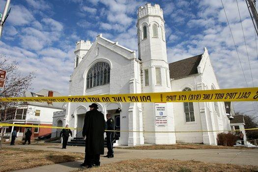 Yellow tape marks the scene of a drive-by shooting as a funeral concluded at the Macedonia Baptist Church on Tuesday.