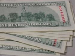 In Grandview, Mo., Secret Santa stamped the $100 bills with the name Bob Beckers, past mayor and chief of police, who died in August.