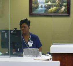 Virrinda Eferakeya checks people in for appointments at the new Swope Health South Clinic.