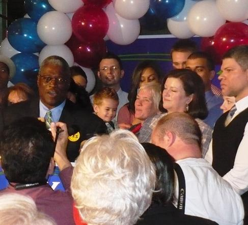 Family and friends surround Sly James during his victory speech.