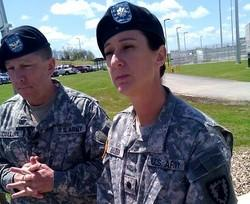 Army prison Commandant, LT.COL. Dawn  Hilton (R), COL Thomas Collins (L) outside complex where PVT. Bradley Manning is held.