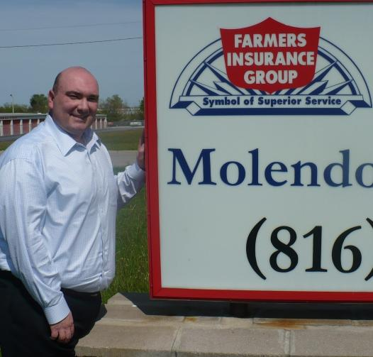 """State rep. Chris Molendorp, author of the \""""Show-Me Health Insurance Exchange Act,\"""" stands outside his insurance agency in Raymore, Mo.  His dad opened the business in 1977 and is still an agent."""