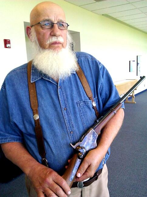 (click to enlarge.) Historian  Arnold Schofield  holds Sharps  carbine, a gun issued Union  cavalry and used in Missouri campaigns.