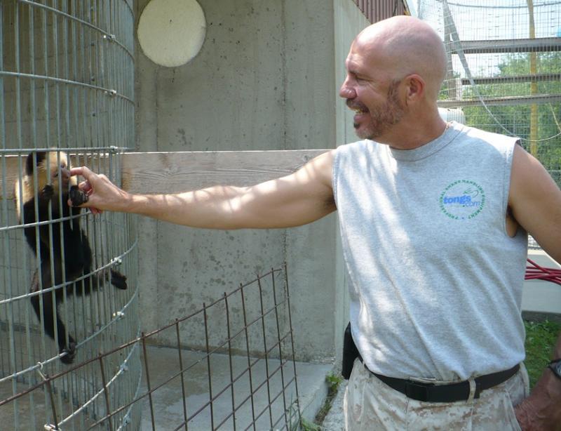 Dana Savorelli and a capuchin monkey. Photo by Sylvia Maria Gross / KCUR.